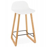 Solid and design white bar stool with beech legs and metal footrest