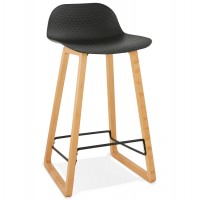 Solid and design black bar stool with beech legs and metal footrest