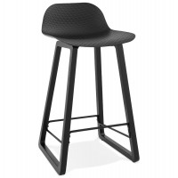 Black bar stool with solid seat and wooden leg with practical footrest